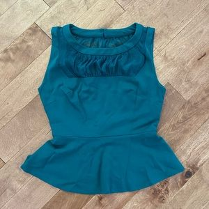 Green Bebe top with sheer cut outs